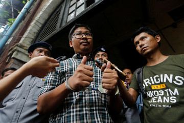 Detained Reuters journalist Wa Lone talk to reporters while leaving the court hearing in Yangon