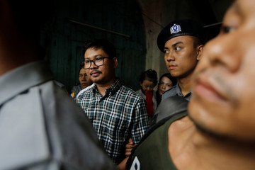 Detained Reuters journalist Wa Lone escort by police while leaving the court hearing in Yangon