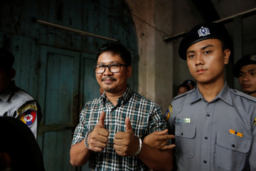 Detained Reuters journalist Wa Lone escort by police out of the court hearing in Yangon