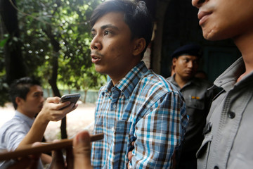 Detained Reuters journalist Kyaw Soe Oo talk to reporters while leaving the court hearing in Yangon