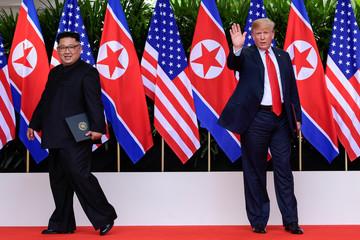 U.S. President Donald Turmp waves as North Korean leader Kim Jong Un leaves after their meeting at the Capella resort on Sentosa Island