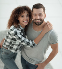 Top view modern young couple standing in new living room