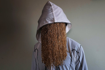 Undercover journalist Anas Aremeyaw Anas poses during an interview with Reuters in Accra