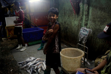 Children working at San Pya seafood wholesell market early in the morning in Yangon