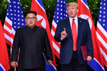 U.S. President Donald Trump makes a statement before saying goodbye to North Korea leader Kim Jong Un after their meeting in the Capella Hotel after their working lunch, on Sentosa island in Singapore