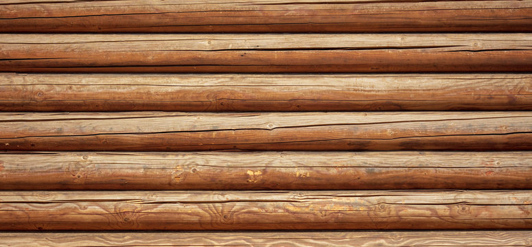 Logs on the wall with a log frame as a background