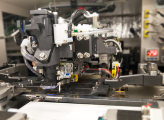 Wall Mural - image not focus of gold wire stamping on lead frame in die attach machine in Semiconductor Manufacturing hi-tech industry, blurred background