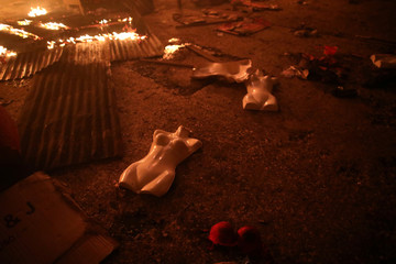 Mannequins lie on the ground during fire at a market in Port-au-Prince