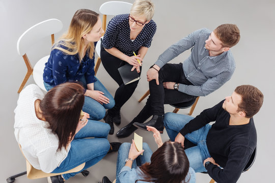 Group of people having a meeting together