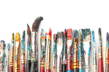 Dirty paint brushes on white background