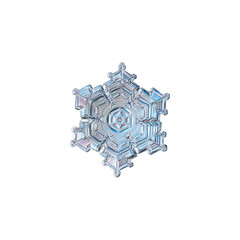 Snowflake isolated on white background. Macro photo of real snow crystal: beautiful star plate with fine hexagonal symmetry, six short, broad arms, glossy relief surface and elegant inner pattern.