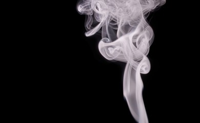 Smoke - steam vaping isolated on black background.