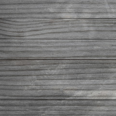 Blank wood pattern wall with grain and scratches. Weathered wood rustic background. Grey brown color Old rough timber..