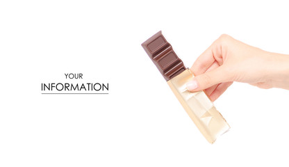 A bar of chocolate in a golden wrapper in hand pattern on white background isolation