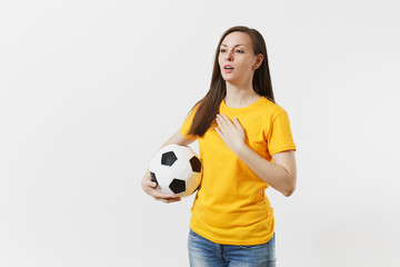 European woman, football fan in yellow uniform holding soccer ball, singing national country anthem isolated on white background. Sport, play football, cheer, fans people support, lifestyle concept.