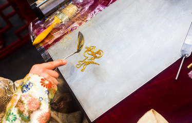 Person making a sugar candy painting