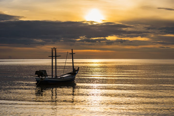 Fishing boat floating in the sea at morning sunshine time.Thailand.