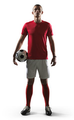 Soccer player standing on white background.
