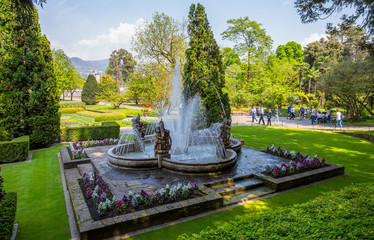 PALLANZA, ITALY, APRIL 25, 2018 - View of Putti Fountain in the botanical garden of Villa Taranto in Pallanza, Verbania, Italy.