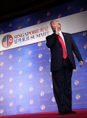U.S. President Donald Trump reacts after a news conference in Singapore