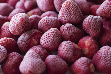 Frozen strawberry close-up. Food background.