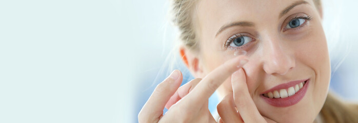 Young woman putting eye contact lense on, template