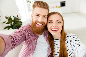 Photographer entertainment two people partners cuddle move house  concept. Close up portrait of excited rejoicing joyful attractive carefree lovely cute couple taking picture in new apartment