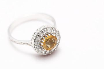 Yellow gem stone and diamond ring