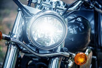Foto op Plexiglas Fiets Motorcycle headlight close up, film blue tone style