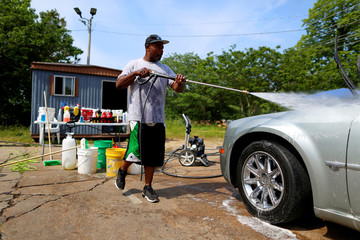 Curtis Busa washes a car in Yazoo City