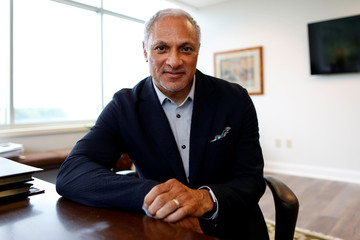 U.S. Senate candidate Mike Espy poses for a photograph at his office in Jackson