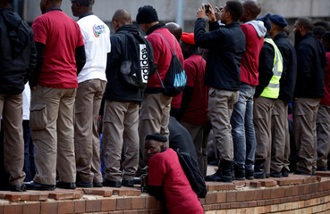 Cash-in-transit workers attend a nationwide protest following a spate of deadly heists this year, in Johannesburg