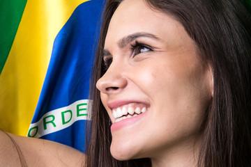 Brazilian female fan celebrating