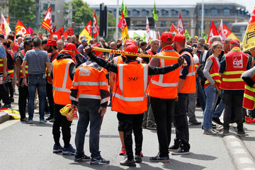 Striking French SNCF railway employees and labour union members attend a demonstration to protest the French government's reform bill in Lyon