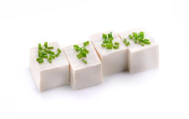 Tofu cubes isolated on white background.
