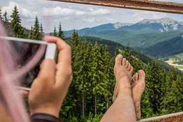 rest concept of woman with bare feet who take photo phone on mountain background nature landscape