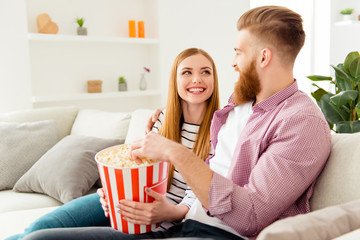 Bearded hipster two partners friendship day lifestyle vacation hobby freetime happiness concept. Joyful rejoicing lovely people watching comedy together eating pop-corn from basket box on holidays