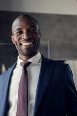 close-up portrait of happy young businessman in stylish suit