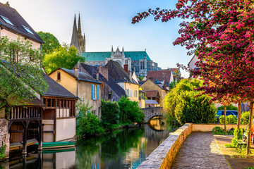 Wall Mural - Eure River embankment with old houses in a small town Chartres, France