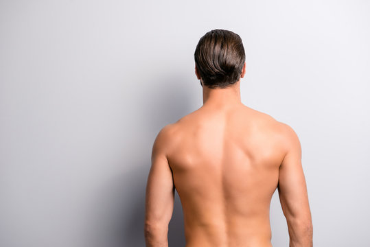 Rear back behind view photo of strong muscular handsome attractive stunning confident ideal perfect sportsman isolated on gray background copyspace