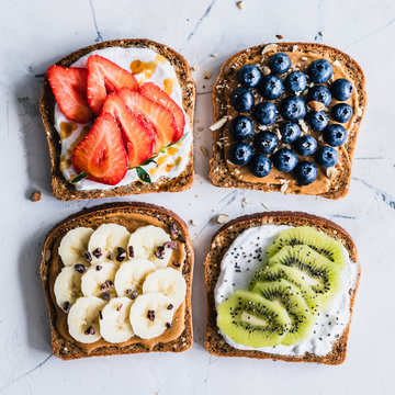 Peanut butter and cream cheese toasts with fresh fruit