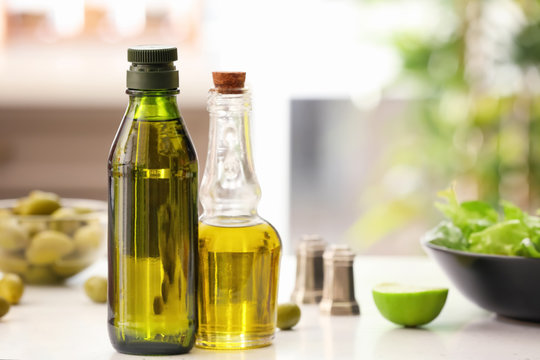 Bottles with olive oil on table