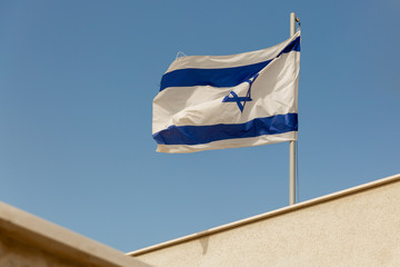 White and blue flag of Israel on roof