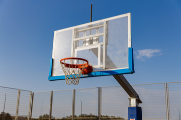 One basketball board under  under the sky at morning