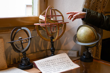 View in an interior of ancient objects of astronomy, globes, astrolabe.