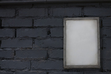 Mock up blank poster picture frame on blue brick wall.