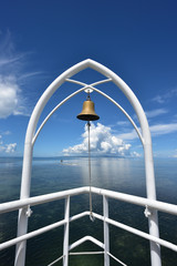 Bell with sky and ocean