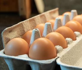 One dozen fresh eggs in a carton