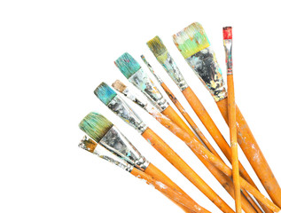 Many dirty paint brushes on white background
