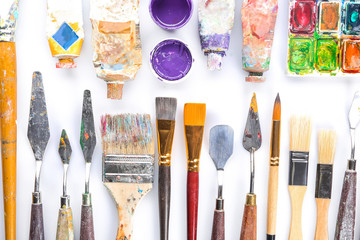 Set of tools with paints on white background